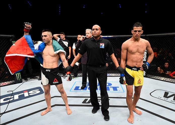 MEXICO CITY, MEXICO - NOVEMBER 05:  (L-R) Ricardo Lamas of the United States celebrates his submission victory over Charles Oliveira of Brazil in their featherweight bout during the UFC Fight Night event at Arena Ciudad de Mexico on November 5, 2016 in Me