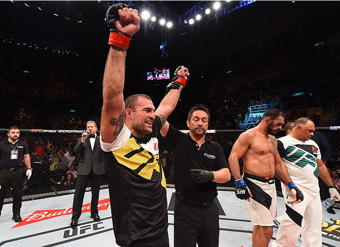 RIO DE JANEIRO, BRAZIL - AUGUST 01:  (L-R) Mauricio 'Shogun' Rua of Brazil celebrates his victory over Rogerio Nogueira of Brazil in their light heavyweight bout during the UFC 190 event inside HSBC Arena on August 1, 2015 in Rio de Janeiro, Brazil.  (Pho