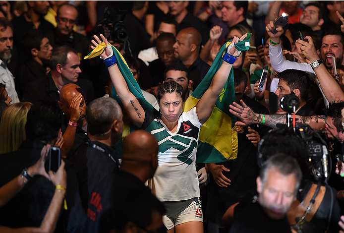RIO DE JANEIRO, BRAZIL - AUGUST 01:  Bethe Correia of Brazil prepares to enter the Octagon before facing Ronda Rousey of the United States in their UFC women's bantamweight championship bout during the UFC 190 event inside HSBC Arena on August 1, 2015 in