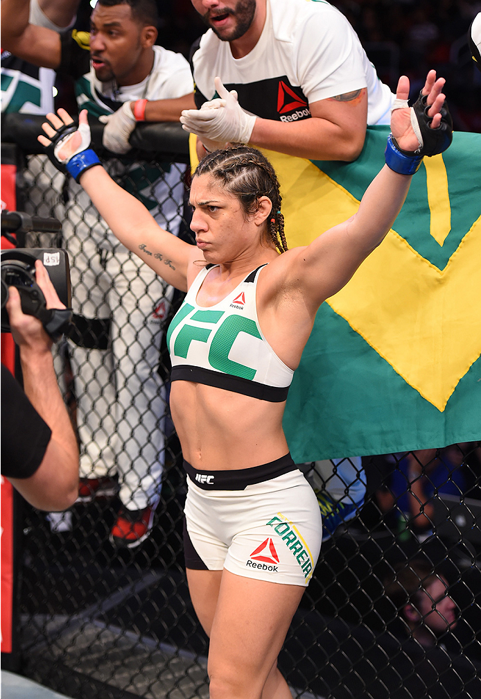 RIO DE JANEIRO, BRAZIL - AUGUST 01:  Bethe Correia of Brazil enters the Octagon before facing Ronda Rousey of the United States in their UFC women's bantamweight championship bout during the UFC 190 event inside HSBC Arena on August 1, 2015 in Rio de Jane