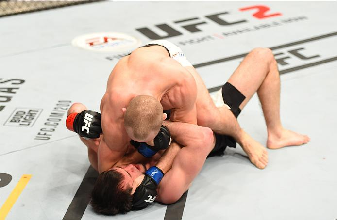 ROTTERDAM, NETHERLANDS - MAY 08:  Gunnar Nelson (top) elbows Albert Tumenov in their welterweight bout during the UFC Fight Night event at Ahoy Rotterdam on May 8, 2016 in Rotterdam, Netherlands. (Photo by Josh Hedges/Zuffa LLC/Zuffa LLC via Getty Images)