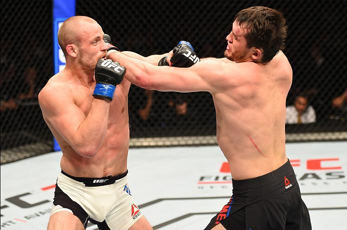 ROTTERDAM, NETHERLANDS - MAY 08:  (L-R) Gunnar Nelson punches Albert Tumenov in their welterweight bout during the UFC Fight Night event at Ahoy Rotterdam on May 8, 2016 in Rotterdam, Netherlands. (Photo by Josh Hedges/Zuffa LLC/Zuffa LLC via Getty Images