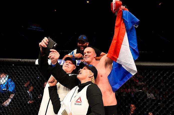 ROTTERDAM, NETHERLANDS - MAY 08:  Stefan Struve takes a selfie with his coaches Bob Schrijber and Irma Verhoeff while celebrating his TKO victory over Antonio Silva in their heavyweight bout during the UFC Fight Night event at Ahoy Rotterdam on May 8, 201