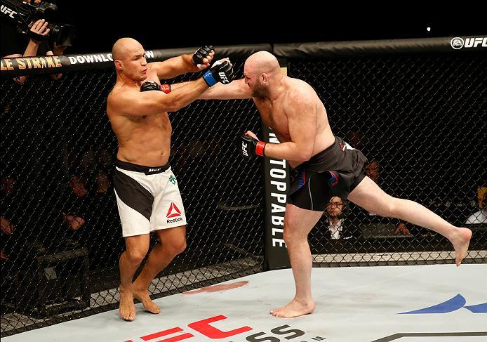 ZAGREB, CROATIA - APRIL 10:   (R-L) Ben Rothwell punches Junior Dos Santos in their heavyweight bout during the UFC Fight Night event at the Arena Zagreb on April 10, 2016 in Zagreb, Croatia. (Photo by Srdjan Stevanovic/Zuffa LLC/Zuffa LLC via Getty Image