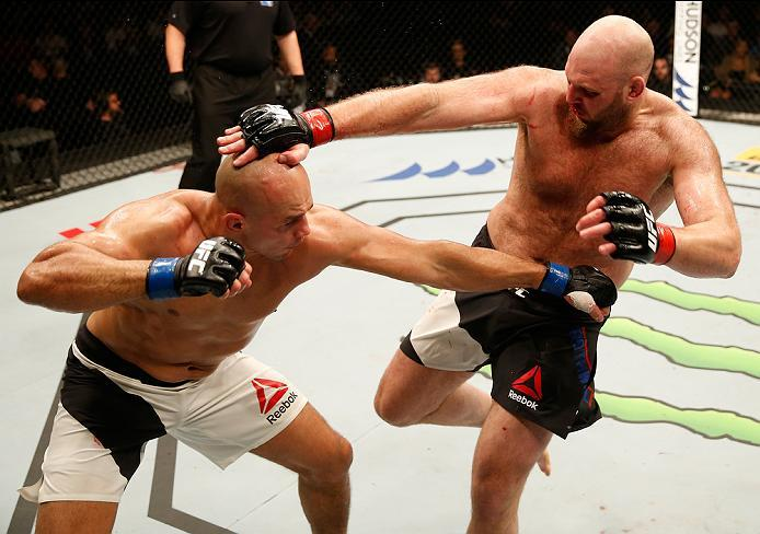 ZAGREB, CROATIA - APRIL 10:   (L-R) Junior Dos Santos punches Ben Rothwell in their heavyweight bout during the UFC Fight Night event at the Arena Zagreb on April 10, 2016 in Zagreb, Croatia. (Photo by Srdjan Stevanovic/Zuffa LLC/Zuffa LLC via Getty Image