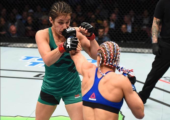 HOUSTON, TX - FEBRUARY 04:  (R-L) Felice Herrig punches Alexa Grasso of Mexico in their women's strawweight bout during the UFC Fight Night event at the Toyota Center on February 4, 2017 in Houston, Texas. (Photo by Jeff Bottari/Zuffa LLC/Zuffa LLC via Ge