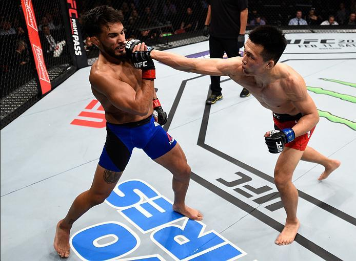 HOUSTON, TX - FEBRUARY 04:  (R-L) Chan Sung Jung of South Korea punches Dennis Bermudez in their featherweight bout during the UFC Fight Night event at the Toyota Center on February 4, 2017 in Houston, Texas. (Photo by Jeff Bottari/Zuffa LLC/Zuffa LLC via