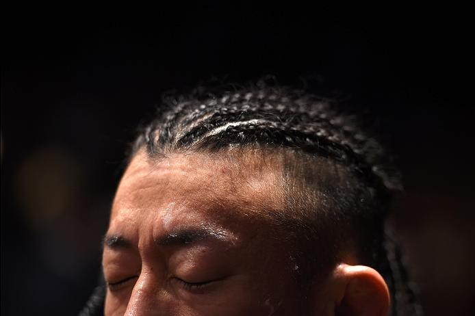 PITTSBURGH, PA - FEBRUARY 21:  Tatsuya Kawajiri prepares to enter the Octagon before facing Dennis Bermudez  in their featherweight bout during the UFC Fight Night event at Consol Energy Center on February 21, 2016 in Pittsburgh, Pennsylvania. (Photo by \