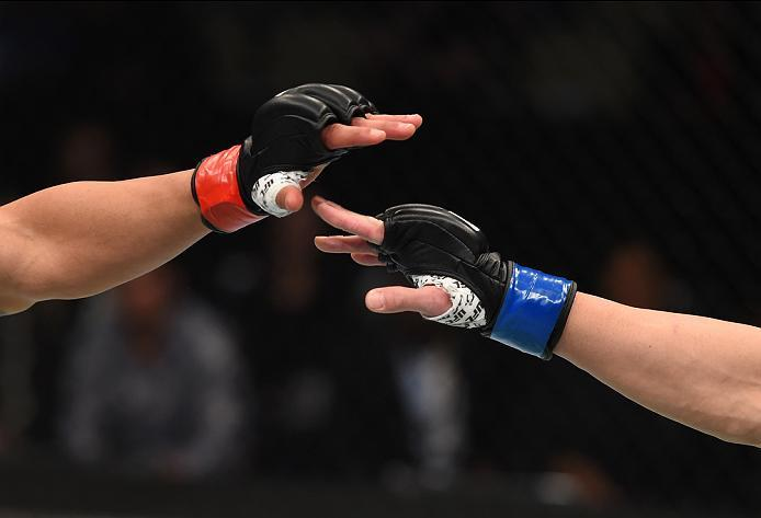 PITTSBURGH, PA - FEBRUARY 21:  (L-R) Dennis Bermudez and Tatsuya Kawajiri touch gloves in their featherweight bout during the UFC Fight Night event at Consol Energy Center on February 21, 2016 in Pittsburgh, Pennsylvania. (Photo by \2026405\/Zuffa LLC/Zuf