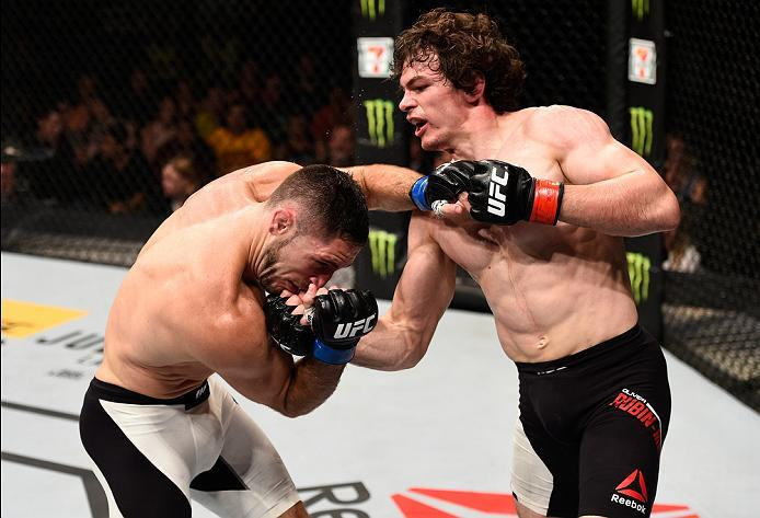 OTTAWA, ON - JUNE 18:   (R-L) Olivier Aubin-Mercier of Canada punches Thibault Gouti of France in their lightweight bout during the UFC Fight Night event inside the TD Place Arena on June 18, 2016 in Ottawa, Ontario, Canada. (Photo by Jeff Bottari/Zuffa L