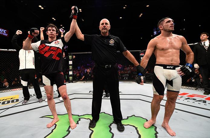 OTTAWA, ON - JUNE 18:   (R-L) Olivier Aubin-Mercier of Canada celebrates his submission victory over Thibault Gouti of France in their lightweight bout during the UFC Fight Night event inside the TD Place Arena on June 18, 2016 in Ottawa, Ontario, Canada.