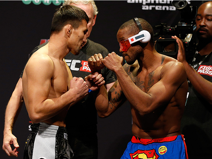 SYDNEY, AUSTRALIA - NOVEMBER 07:  (L-R) Opponents Jumabieke Tuerxun of China and Marcus Brimage of the United States face off during the UFC Fight Night weigh-in at the Allphones Arena on November 7, 2014 in Sydney, Australia. (Photo by Josh Hedges/Zuffa