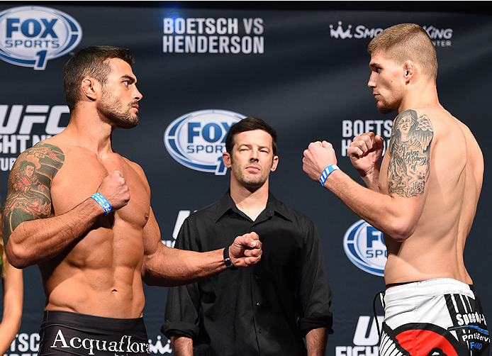 NEW ORLEANS, LA - JUNE 05:   (L-R) Opponents Ricardo Abreu of Brazil and Jake Collier face off during the UFC weigh-in at the Smoothie King Center on June 5, 2015 in New Orleans, Louisiana. (Photo by Josh Hedges/Zuffa LLC/Zuffa LLC via Getty Images)