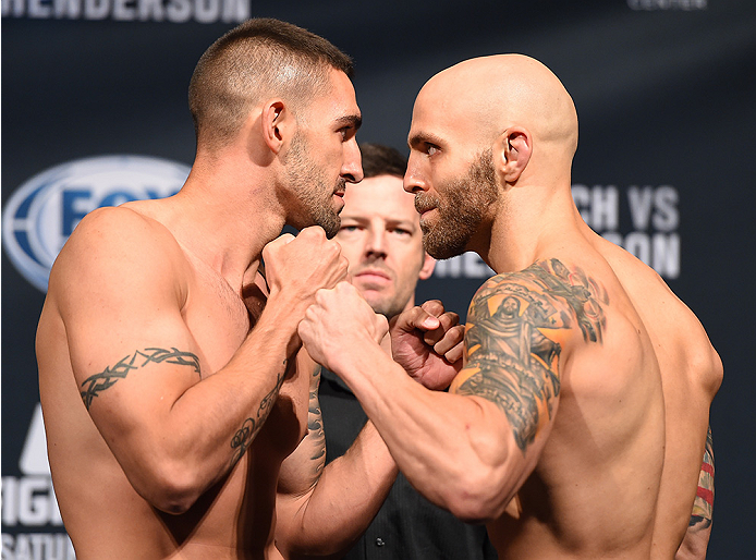 NEW ORLEANS, LA - JUNE 05:   (L-R) Opponents Joe Proctor and Justin Edwards face off during the UFC weigh-in at the Smoothie King Center on June 5, 2015 in New Orleans, Louisiana. (Photo by Josh Hedges/Zuffa LLC/Zuffa LLC via Getty Images)