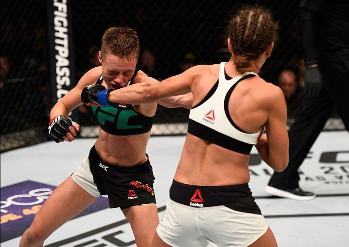 ATLANTA, GA - JULY 30:  (L-R) Rose Namajunas exchanges punches with Karolina Kowalkiewicz in their women's strawweight bout during the UFC 201 event on July 30, 2016 at Philips Arena in Atlanta, Georgia. (Photo by Jeff Bottari/Zuffa LLC/Zuffa LLC via Gett