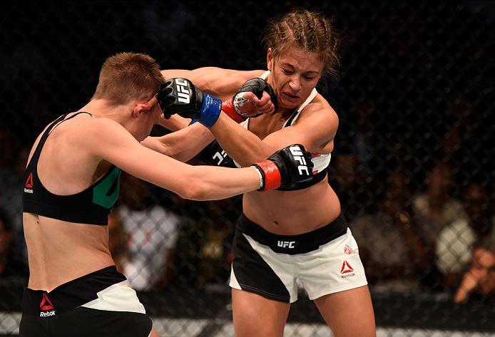 ATLANTA, GA - JULY 30:  (L-R) Rose Namajunas punches Karolina Kowalkiewicz in their women's strawweight bout during the UFC 201 event on July 30, 2016 at Philips Arena in Atlanta, Georgia. (Photo by Jeff Bottari/Zuffa LLC/Zuffa LLC via Getty Images)