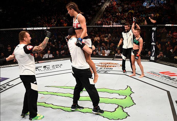 ATLANTA, GA - JULY 30:  (L-R) Karolina Kowalkiewicz gets raised after facing Rose Namajunas in their women's strawweight bout during the UFC 201 event on July 30, 2016 at Philips Arena in Atlanta, Georgia. (Photo by Jeff Bottari/Zuffa LLC/Zuffa LLC via Ge