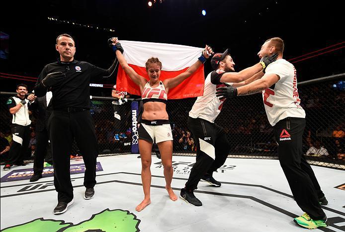 ATLANTA, GA - JULY 30:  Karolina Kowalkiewicz celebrates her victory over Rose Namajunas in their women's strawweight bout during the UFC 201 event on July 30, 2016 at Philips Arena in Atlanta, Georgia. (Photo by Jeff Bottari/Zuffa LLC/Zuffa LLC via Getty