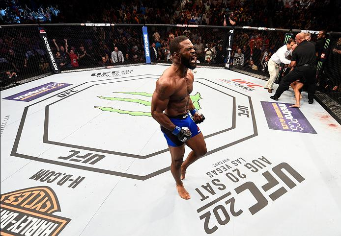 ATLANTA, GA - JULY 30:  (L-R) Tyron Woodley celebrates his knockout victory over Robbie Lawler in their welterweight championship bout during the UFC 201 event on July 30, 2016 at Philips Arena in Atlanta, Georgia. (Photo by Jeff Bottari/Zuffa LLC/Zuffa L