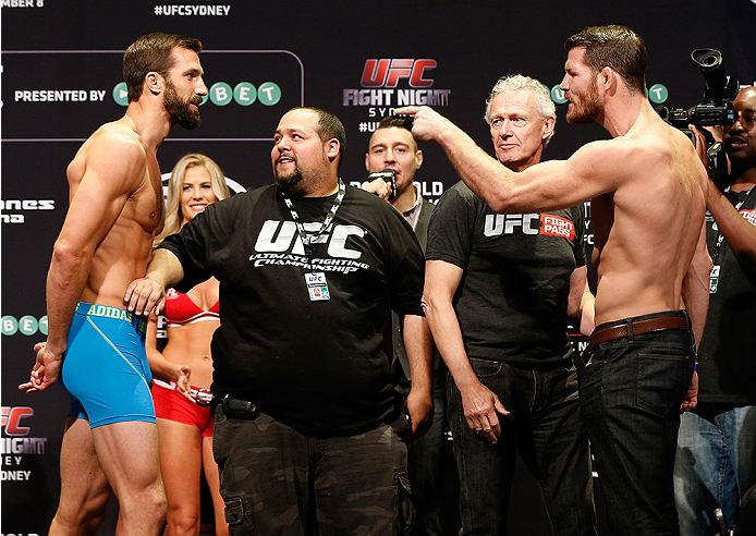SYDNEY, AUSTRALIA - NOVEMBER 07:  (L-R) Opponents Luke Rockhold of the United States and Michael Bisping of England face off during the UFC Fight Night weigh-in at the Allphones Arena on November 7, 2014 in Sydney, Australia. (Photo by Josh Hedges/Zuffa L
