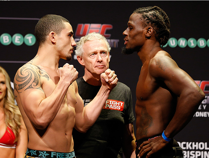 SYDNEY, AUSTRALIA - NOVEMBER 07:  (L-R) Opponents Robert Whittaker of New Zealand and Clint Hester of the United States face off during the UFC Fight Night weigh-in at the Allphones Arena on November 7, 2014 in Sydney, Australia. (Photo by Josh Hedges/Zuf