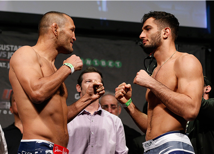 STOCKHOLM, SWEDEN - JANUARY 23:  (L-R) Opponents Dan Henderson of the United States and Gegard Mousasi of the Netherlands face off during the UFC Fight Night Weigh-ins at the Hovet Arena on January 23, 2015 in Stockholm, Sweden. (Photo by Josh Hedges/Zuff
