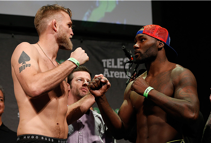 STOCKHOLM, SWEDEN - JANUARY 23:  (L-R) Opponents Alexander Gustafsson of Sweden and Anthony Johnson of the United States face off during the UFC Fight Night Weigh-ins at the Hovet Arena on January 23, 2015 in Stockholm, Sweden. (Photo by Josh Hedges/Zuffa