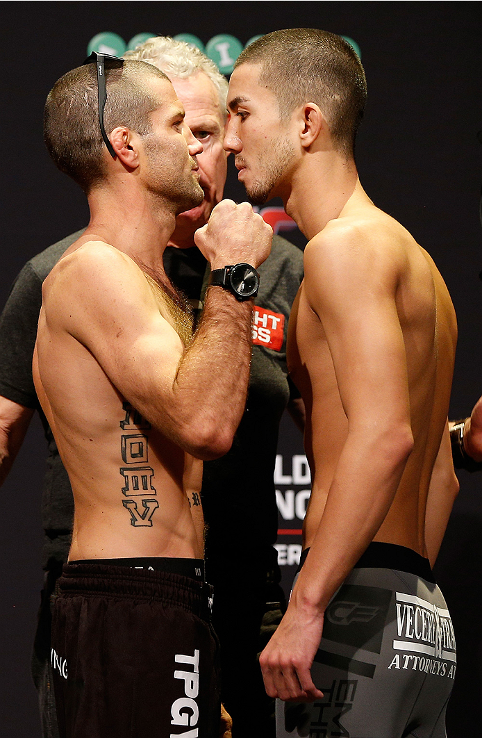 SYDNEY, AUSTRALIA - NOVEMBER 07:  (L-R) Opponents Richie Vaculik of Australia and Louis Smolka of the United States face off during the UFC Fight Night weigh-in at the Allphones Arena on November 7, 2014 in Sydney, Australia. (Photo by Josh Hedges/Zuffa L