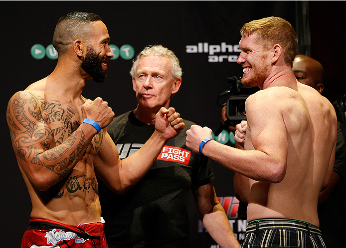 SYDNEY, AUSTRALIA - NOVEMBER 07:  (L-R) Opponents Dylan Andrews of New Zealand and Sam Alvey of the United States face off during the UFC Fight Night weigh-in at the Allphones Arena on November 7, 2014 in Sydney, Australia. (Photo by Josh Hedges/Zuffa LLC