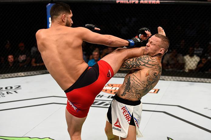 ATLANTA, GA - JULY 30:  (L-R) Jorge Masvidal kicks Ross Pearson in their welterweight bout during the UFC 201 event on July 30, 2016 at Philips Arena in Atlanta, Georgia. (Photo by Jeff Bottari/Zuffa LLC/Zuffa LLC via Getty Images)