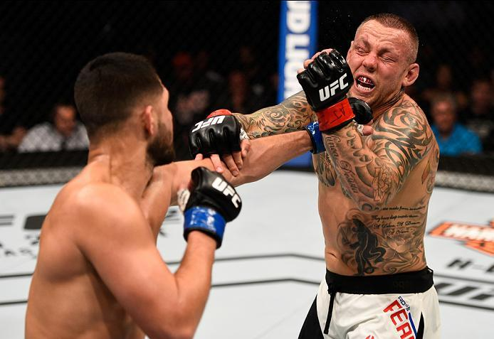 ATLANTA, GA - JULY 30:  (L-R) Jorge Masvidal punches Ross Pearson in their welterweight bout during the UFC 201 event on July 30, 2016 at Philips Arena in Atlanta, Georgia. (Photo by Jeff Bottari/Zuffa LLC/Zuffa LLC via Getty Images)