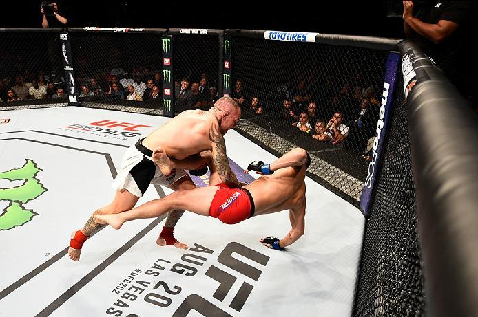 ATLANTA, GA - JULY 30:  (L-R) Ross Pearson trips Jorge Masvidal in their welterweight bout during the UFC 201 event on July 30, 2016 at Philips Arena in Atlanta, Georgia. (Photo by Jeff Bottari/Zuffa LLC/Zuffa LLC via Getty Images)