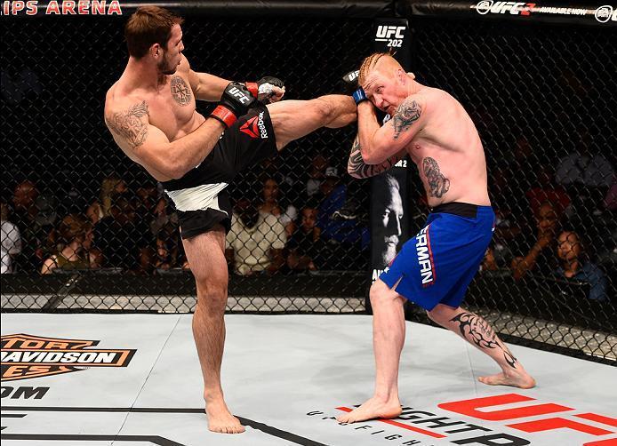 ATLANTA, GA - JULY 30:  (L-R) Nikita Krylov kicks Ed Herman in their light heavyweight bout during the UFC 201 event on July 30, 2016 at Philips Arena in Atlanta, Georgia. (Photo by Jeff Bottari/Zuffa LLC/Zuffa LLC via Getty Images)