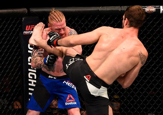 ATLANTA, GA - JULY 30:  (R-L) Nikita Krylov kicks Ed Herman in their light heavyweight bout during the UFC 201 event on July 30, 2016 at Philips Arena in Atlanta, Georgia. (Photo by Jeff Bottari/Zuffa LLC/Zuffa LLC via Getty Images)