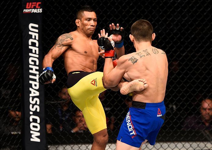 ATLANTA, GA - JULY 30:  (L-R) Fredy Serrano kicks Ryan Benoit in their flyweight bout during the UFC 201 event on July 30, 2016 at Philips Arena in Atlanta, Georgia. (Photo by Jeff Bottari/Zuffa LLC/Zuffa LLC via Getty Images)