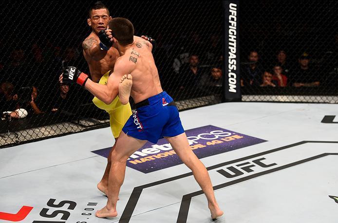 ATLANTA, GA - JULY 30:  (R-L) Ryan Benoit punches Fredy Serrano in their flyweight bout during the UFC 201 event on July 30, 2016 at Philips Arena in Atlanta, Georgia. (Photo by Jeff Bottari/Zuffa LLC/Zuffa LLC via Getty Images)