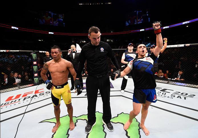 ATLANTA, GA - JULY 30:  (R-L) Ryan Benoit celebrates his victory over Fredy Serrano in their flyweight bout during the UFC 201 event on July 30, 2016 at Philips Arena in Atlanta, Georgia. (Photo by Jeff Bottari/Zuffa LLC/Zuffa LLC via Getty Images)