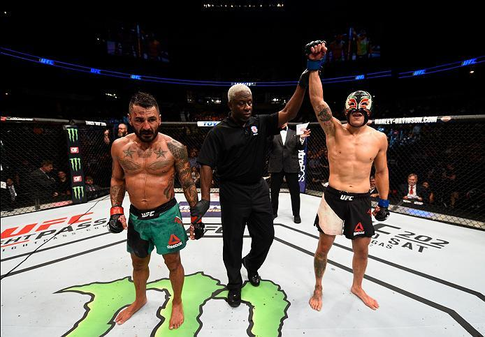ATLANTA, GA - JULY 30:  (R-L) Erik Perez celebrates his victory over Francisco Rivera with a spinning back fistin their bantamweight bout during the UFC 201 event on July 30, 2016 at Philips Arena in Atlanta, Georgia. (Photo by Jeff Bottari/Zuffa LLC/Zuff