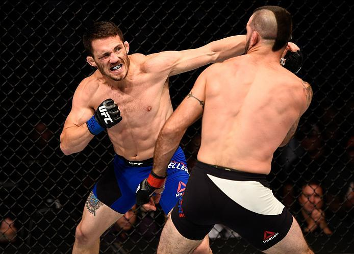 ATLANTA, GA - JULY 30:  (L-R) Jake Ellenberger punches Matt Brown in their welterweight bout during the UFC 201 event on July 30, 2016 at Philips Arena in Atlanta, Georgia. (Photo by Jeff Bottari/Zuffa LLC/Zuffa LLC via Getty Images)