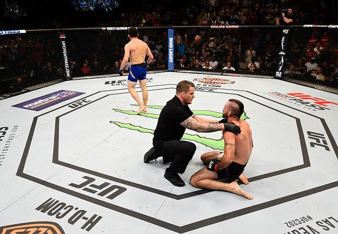 ATLANTA, GA - JULY 30:  (L-R) Jake Ellenberger celebrates his victory over Matt Brown in their welterweight bout during the UFC 201 event on July 30, 2016 at Philips Arena in Atlanta, Georgia. (Photo by Jeff Bottari/Zuffa LLC/Zuffa LLC via Getty Images)