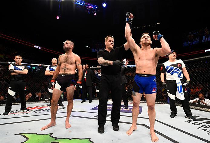 ATLANTA, GA - JULY 30:  (R-L) Jake Ellenberger celebrates his victory over Matt Brown in their welterweight bout during the UFC 201 event on July 30, 2016 at Philips Arena in Atlanta, Georgia. (Photo by Jeff Bottari/Zuffa LLC/Zuffa LLC via Getty Images)