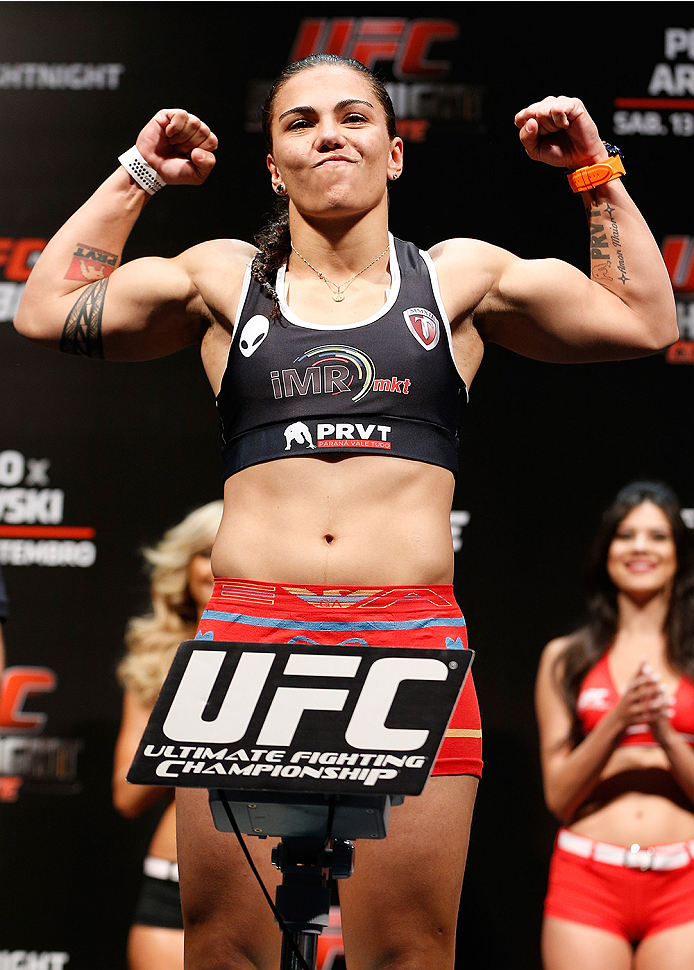 BRASILIA, BRAZIL - SEPTEMBER 12:  Jessica Andrade of Brazil poses on the scale after weighing in during the UFC Fight Night weigh-in at the Nilson Nelson Gymnasium on September 12, 2014 in Brasilia, Brazil. (Photo by Josh Hedges/Zuffa LLC/Zuffa LLC via Ge