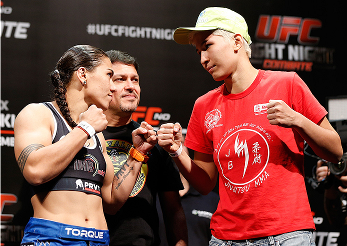 BRASILIA, BRAZIL - SEPTEMBER 12:  (L-R) Opponents Jessica Andrade of Brazil and Larissa Pacheco of Brazil face off during the UFC Fight Night weigh-in at the Nilson Nelson Gymnasium on September 12, 2014 in Brasilia, Brazil. (Photo by Josh Hedges/Zuffa LL