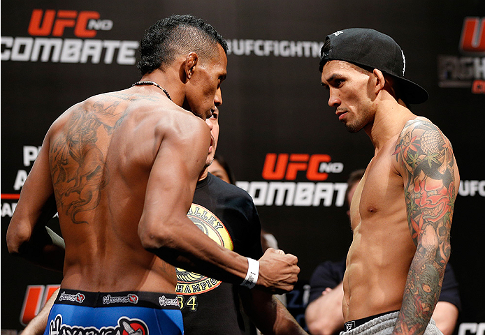 BRASILIA, BRAZIL - SEPTEMBER 12:  (L-R) Opponents Iuri Alcantara of Brazil and Russell Doane face off during the UFC Fight Night weigh-in at the Nilson Nelson Gymnasium on September 12, 2014 in Brasilia, Brazil. (Photo by Josh Hedges/Zuffa LLC/Zuffa LLC v