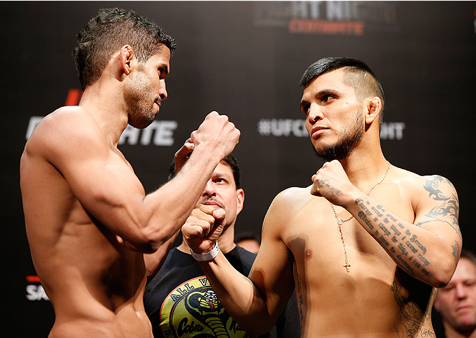 BRASILIA, BRAZIL - SEPTEMBER 12:  (L-R) Opponents Leonardo Santos of Brazil and Efrain Escudero of Mexico face off during the UFC Fight Night weigh-in at the Nilson Nelson Gymnasium on September 12, 2014 in Brasilia, Brazil. (Photo by Josh Hedges/Zuffa LL