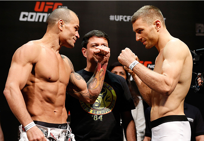 BRASILIA, BRAZIL - SEPTEMBER 12:  (L-R) Opponents Gleison Tibau of Brazil and Piotr Hallmann of Poland face off during the UFC Fight Night weigh-in at the Nilson Nelson Gymnasium on September 12, 2014 in Brasilia, Brazil. (Photo by Josh Hedges/Zuffa LLC/Z