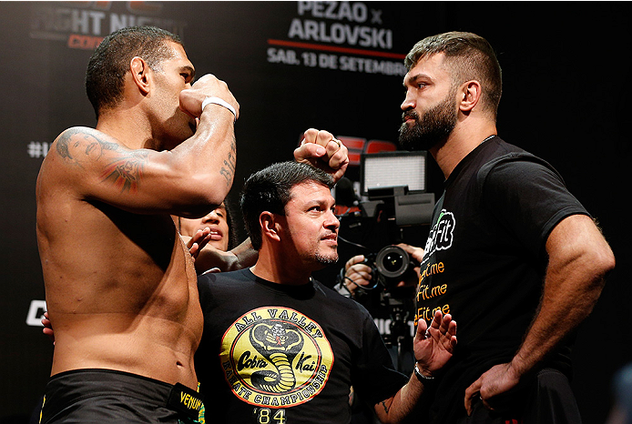 """BRASILIA, BRAZIL - SEPTEMBER 12:  (L-R) Opponents Antonio """"Bigfoot"""" Silva of Brazil and Andrei Arlovski of Belarus face off during the UFC Fight Night weigh-in at the Nilson Nelson Gymnasium on September 12, 2014 in Brasilia, Brazil. (Photo by Josh Hedges"""