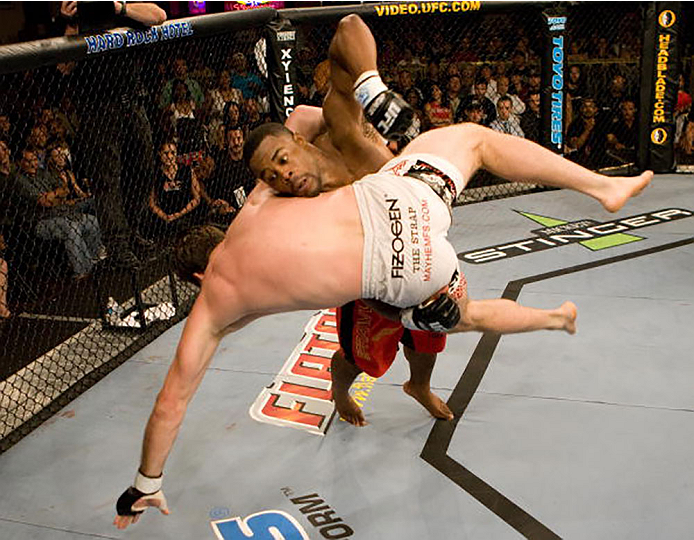 LAS VEGAS - JUNE 28:  (R-L) Rashad Evans takes down Stephan Bonnar at UFC Fight Night 5 at the Joint at the Hard Rock on June 28, 2006 in Las Vegas, Nevada.  (Photo by Josh Hedges/Zuffa LLC/Zuffa LLC via Getty Images)