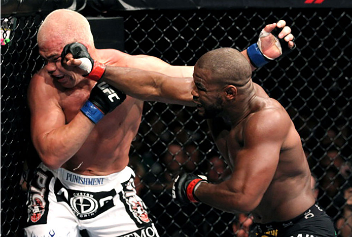 PHILADELPHIA, PA - AUGUST 06:  (R-L) Rashad Evans punches Tito Ortiz during a light heavyweight bout at UFC 133 at Wells Fargo Center on August 6, 2011 in Philadelphia, Pennsylvania.  (Photo by Al Bello/Zuffa LLC/Zuffa LLC via Getty Images)
