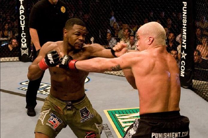 SACRAMENTO, CA - JULY 7:  Rashad Evans (green shorts) vs. Tito Ortiz (black/flame shorts) - Draw during UFC 73 at Arco Arena on July 7, 2007 in Sacramento, California. (Photo by Josh Hedges/Zuffa LLC via Getty Images)